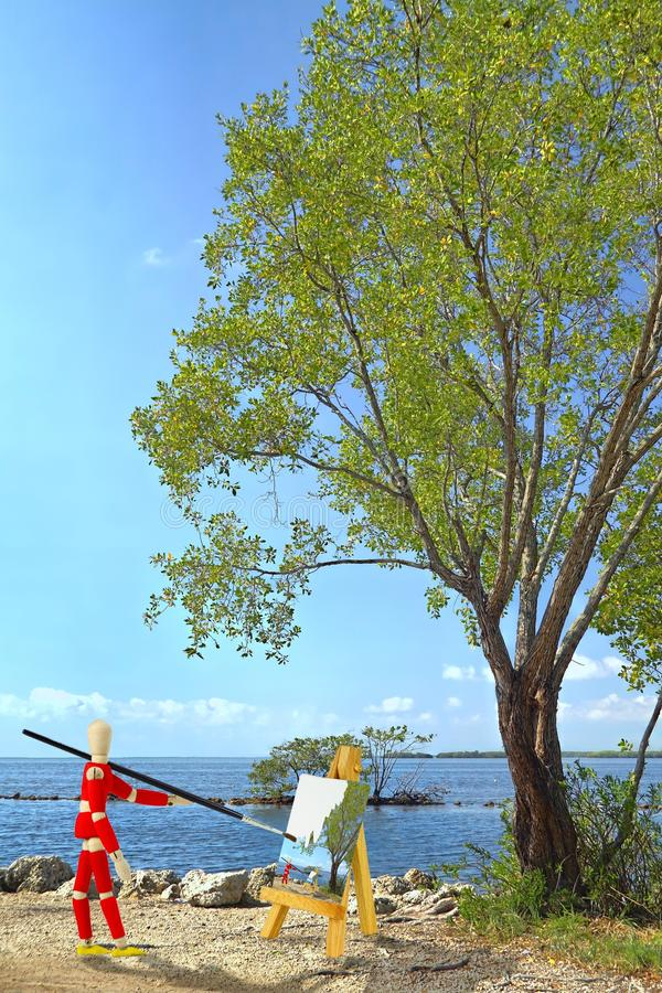 Houten ledenpop die een landschap schildert royalty-vrije stock foto's