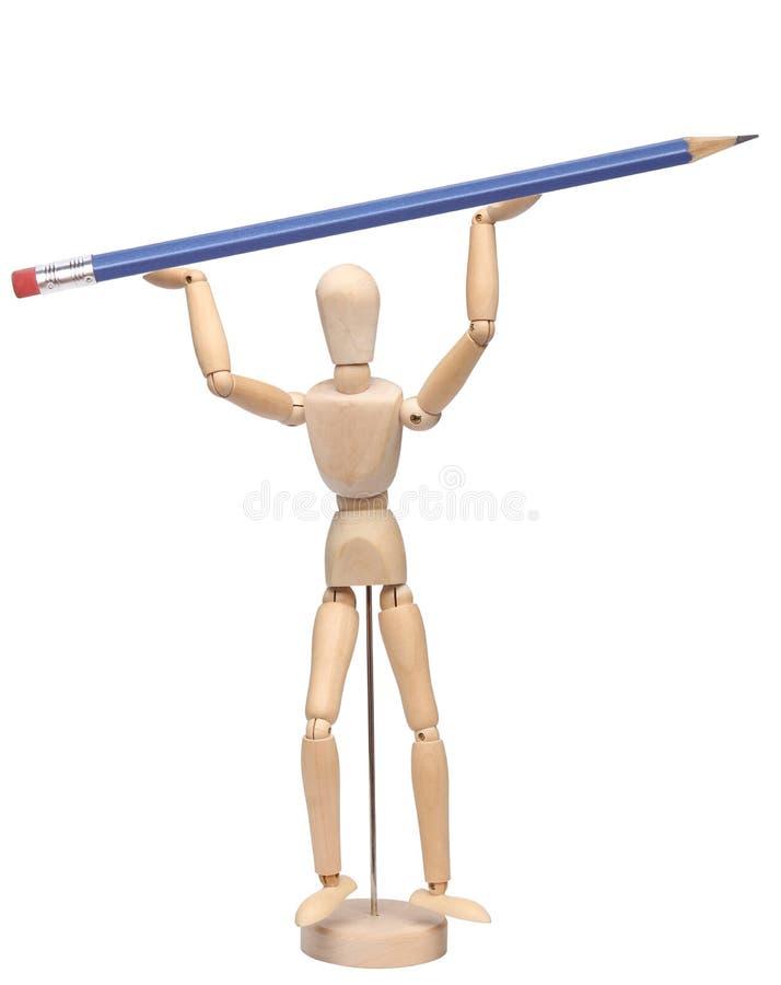 Houten ledenpop die een potlood houdt stock afbeeldingen