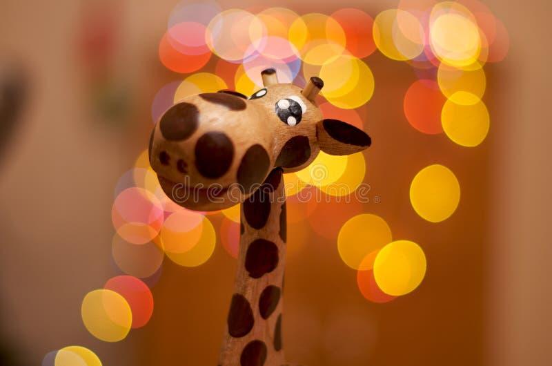 Houten leuke giraf stock afbeeldingen