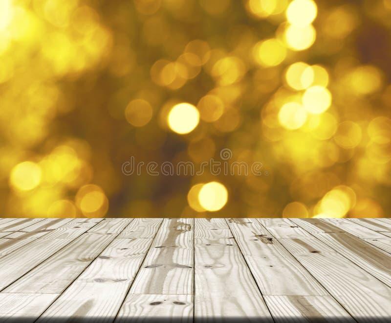 Houten lijstbovenkant op onscherp geel bokehlicht stock fotografie