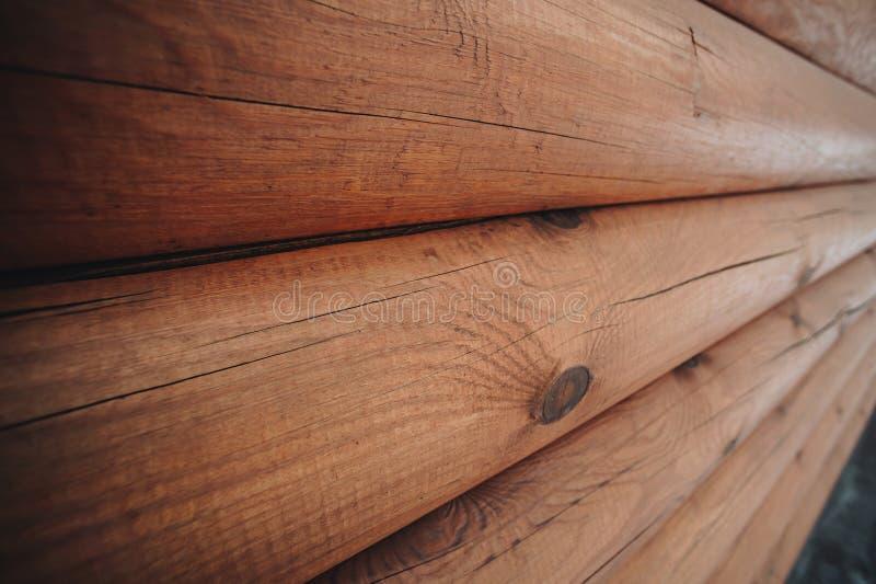 Houten muur van logboeken stock foto's