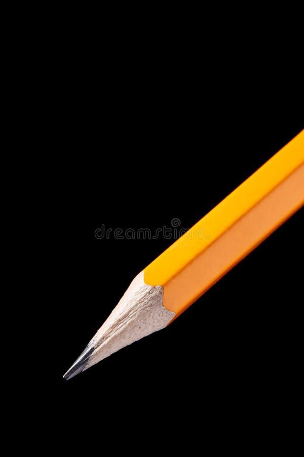 Houten oranje die potlood op zwarte achtergrond wordt geïsoleerd royalty-vrije stock foto