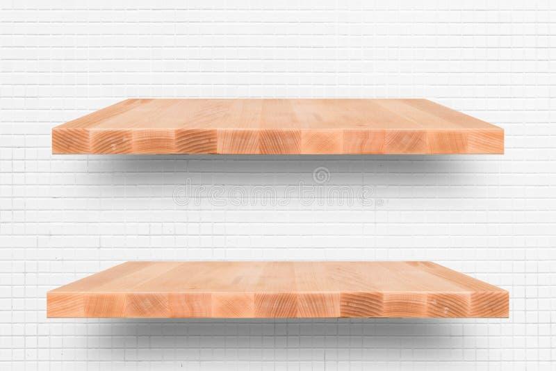 Houten plank op de witte achtergrond van de tegelmuur - kan voor Di worden gebruikt royalty-vrije stock foto's