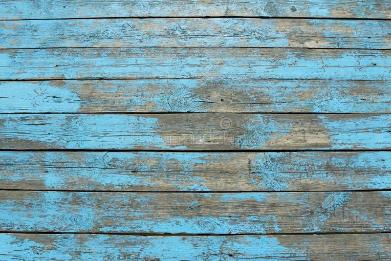 Houten planken met het pellen van blauwe verf royalty-vrije stock fotografie