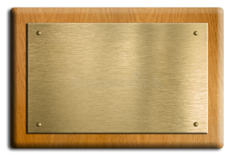 Houten plaque met goud of messingsplaat stock foto
