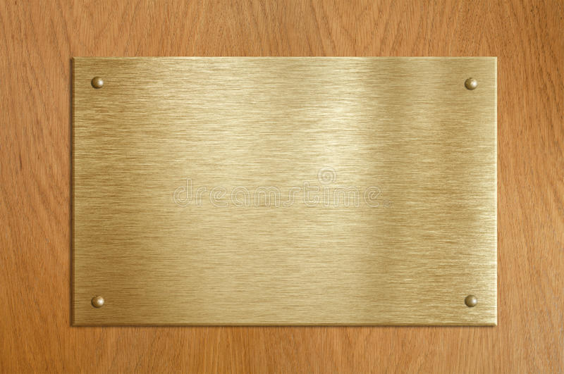 Houten plaque met goud of messingsplaat royalty-vrije stock fotografie