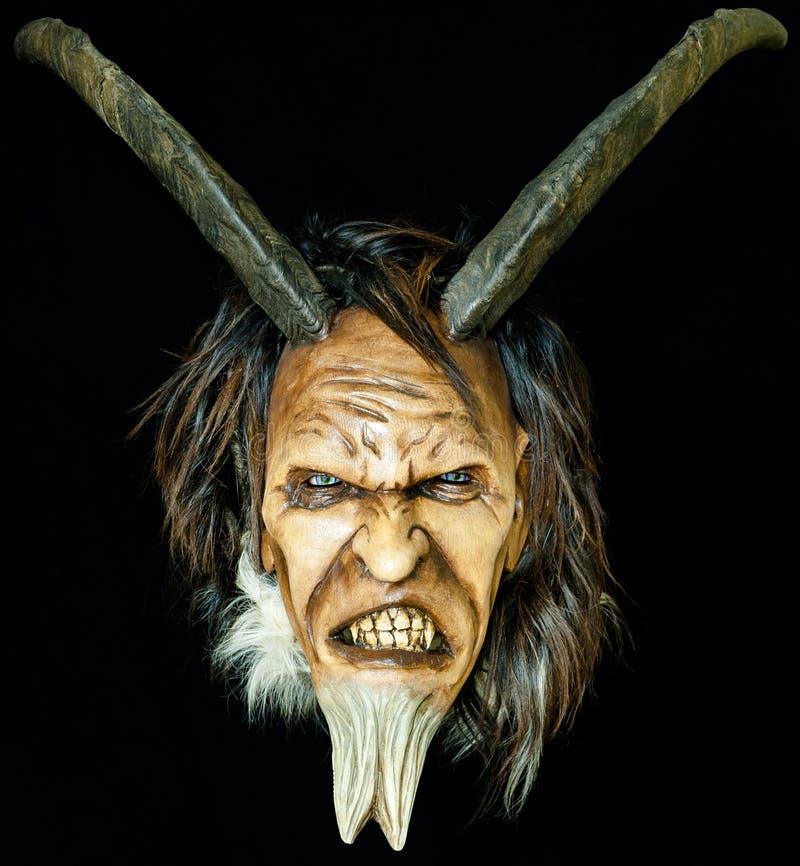 Houten satan kwaad masker royalty-vrije stock foto's