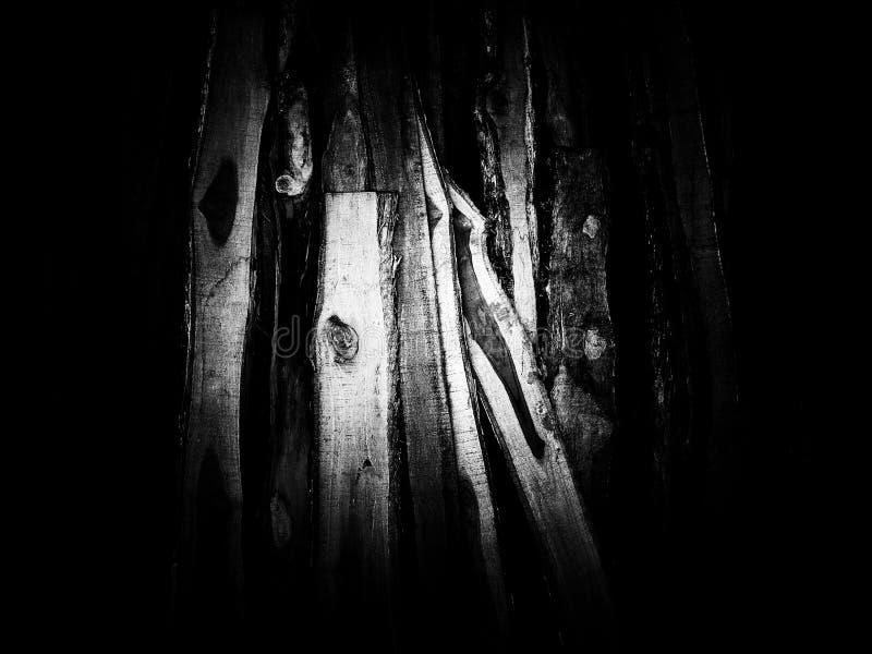 Houten stapeltextuur op zwart-wit stock fotografie