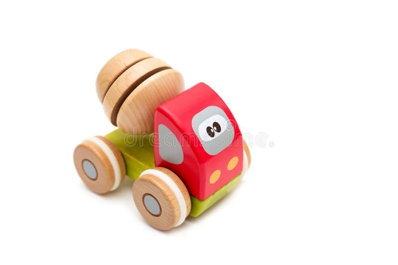 Houten stuk speelgoed auto op een witte achtergrond Geïsoleerde voorwerpen stock foto's