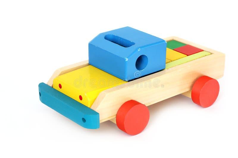 Houten stuk speelgoed op een witte achtergrond Auto royalty-vrije stock foto