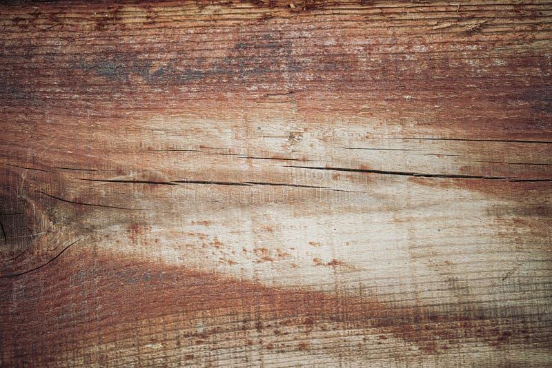 Houten textuur in bruine tonen Oude landelijke houten muur, gedetailleerde de fotoachtergrond van de plankomheining royalty-vrije stock afbeelding