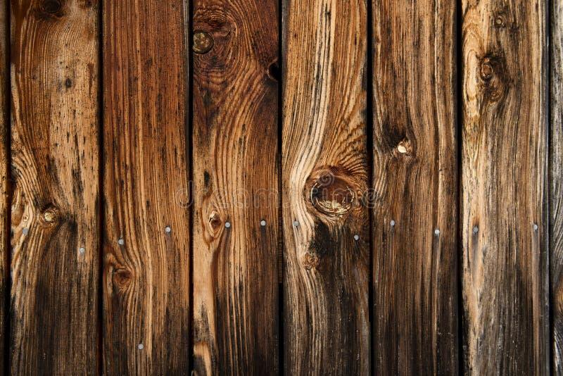 Houten textuur - zeer oude en versleten houten planken stock foto's
