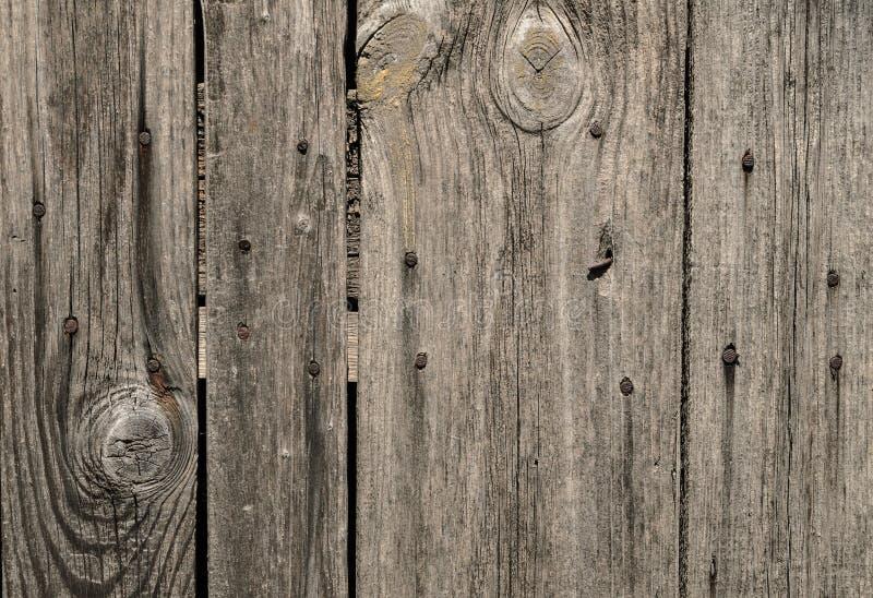 Houten textuurmuur met spijkers stock afbeeldingen