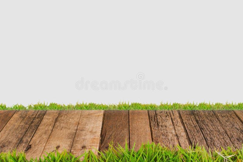 Houten vloer met groen gras stock afbeeldingen