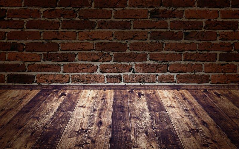 Houten vloer voor een donkere bakstenen muur stock foto's