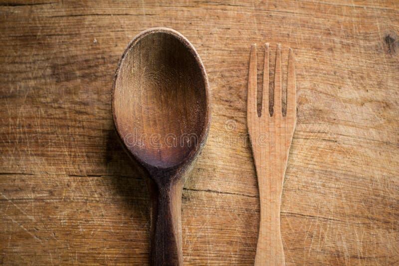 Houten vork en lepel stock afbeelding