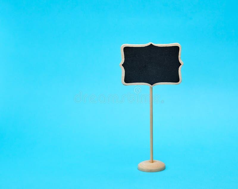 houten wijzer op een stok voor het schrijven van tekst royalty-vrije stock foto's