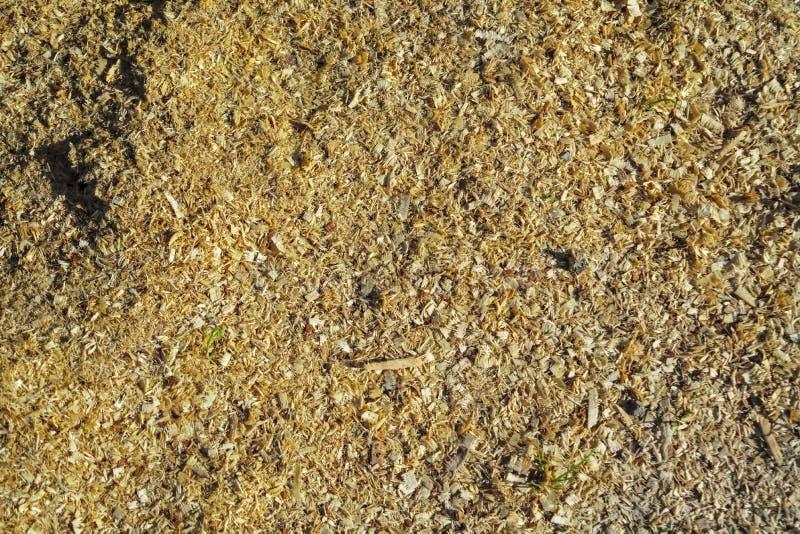 Houten zaagselclose-up als achtergrond Zaagseltextuur, close-upachtergrond van bruin zaagsel stock fotografie