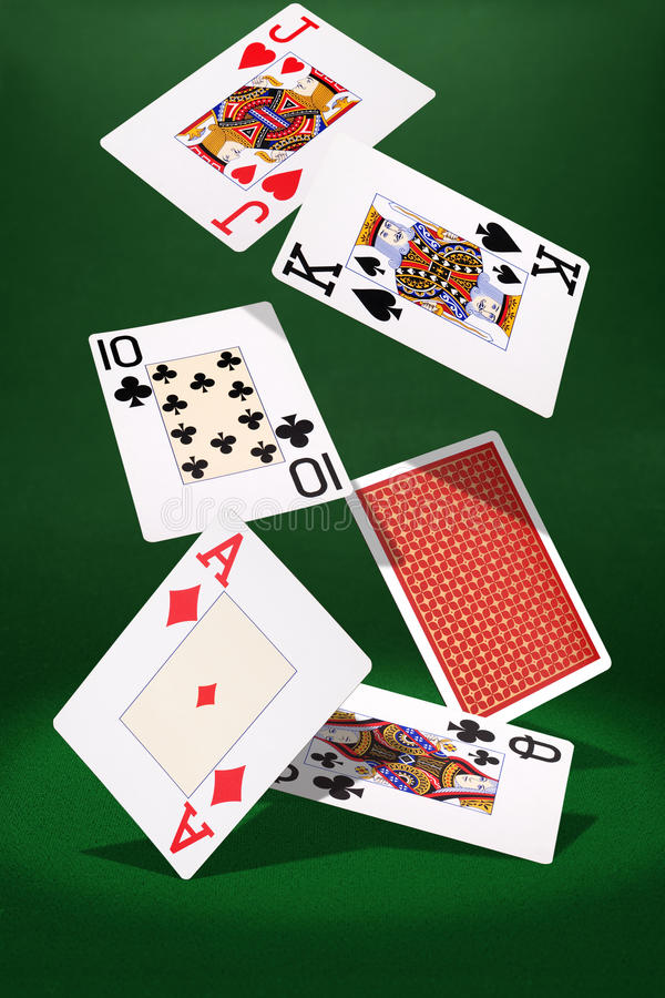 Hover playing cards. Hover plaing cards on green background stock photo