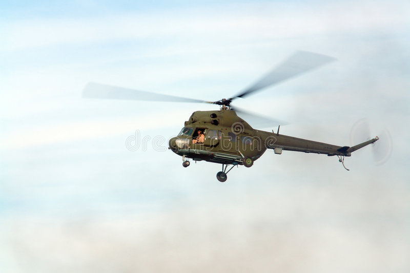 Hovering helicopter royalty free stock image