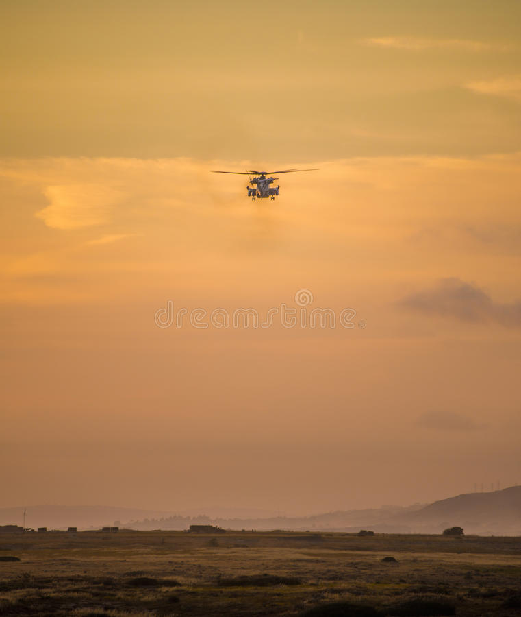 Hovering helicopter. A pave lo helicopter hovering just off the california coast stock photo