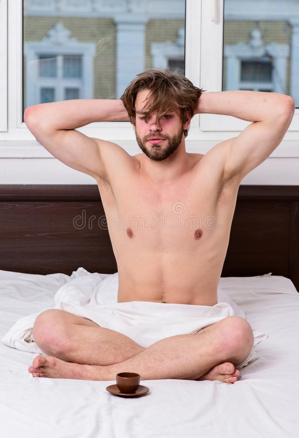 How coffee affects your body from first sip. Coffee fills you with energy. Every morning with his coffee. Man handsome royalty free stock photo