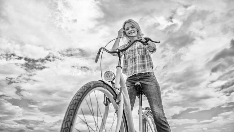 How cycling changes your life and make you happy. Reasons to ride bicycle. Mental health benefits. Pedaling towards. Happiness. Girl rides bicycle sky royalty free stock photography
