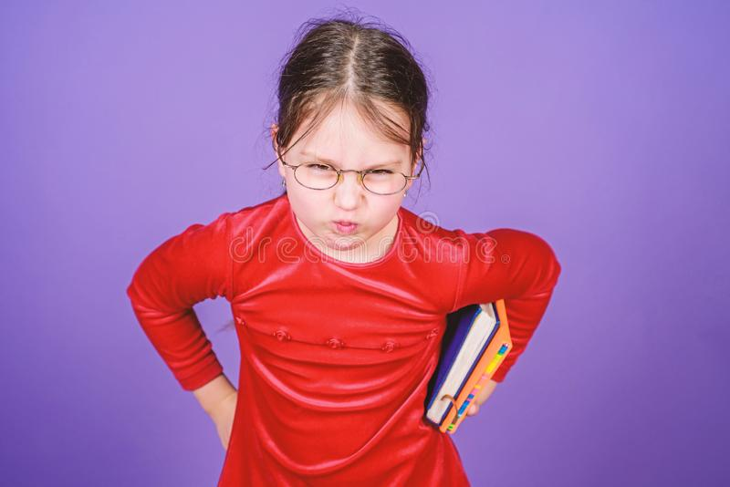 How dare you. Education and kids literature. Adorable girl love books. Kid girl with book or notepad. Back to school. Concept. Reading book as hobby. Girlish stock photo