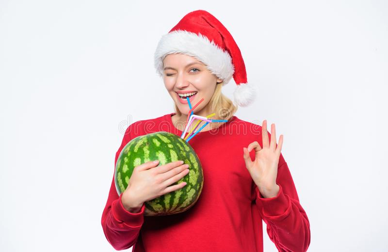 How detox after christmas. Girl wear santa hat drink watermelon vitamin cocktail straw. Winter vitamin fruit ration royalty free stock photos