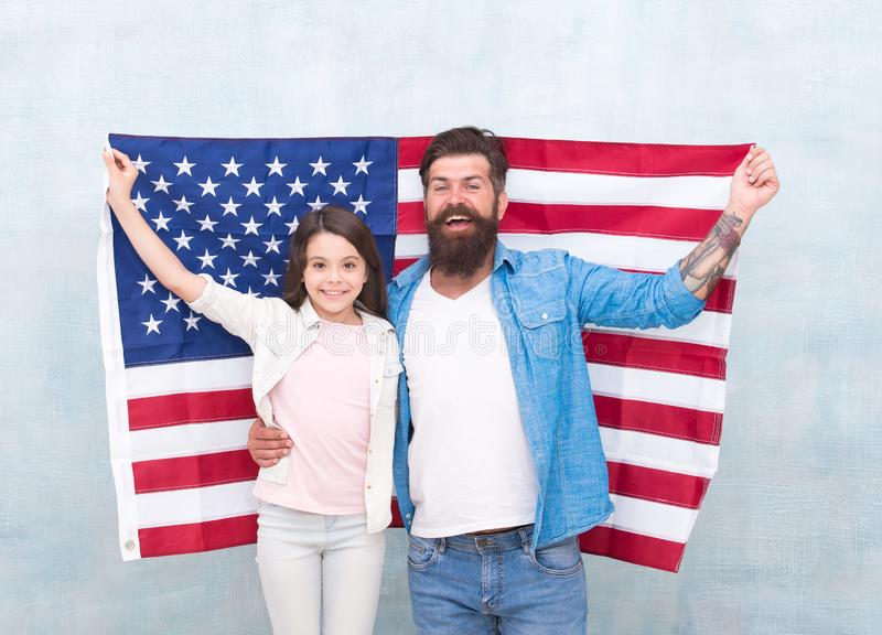 How do americans celebrate independence day. Father and daughter with USA flag. Patriotic family. Independence day is. Chance for family members to reunite and royalty free stock images