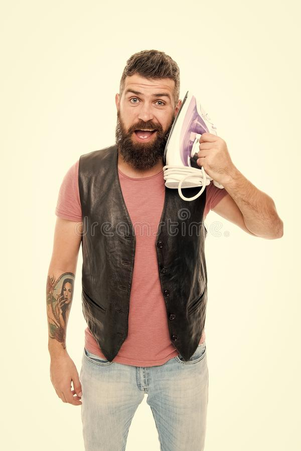 How do you hear me. Unshaven brutal man talking to iron device in hand. Bearded man holding clothes iron. Hipster with. Electric ironing tool. Household ironing stock images