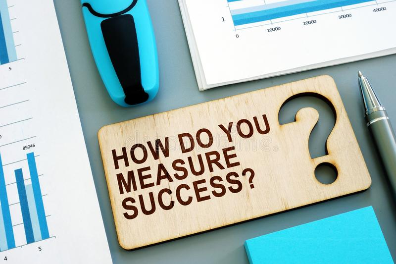 How do you measure success written sign and business report. royalty free stock photos