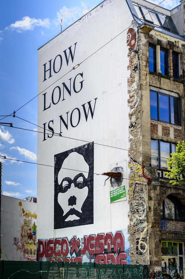 How long is now graffiti on a building wall in Berlin. A large side building wall graffiti with the question 'How long is now' in Oranienburger Strasse in Berlin royalty free stock photo