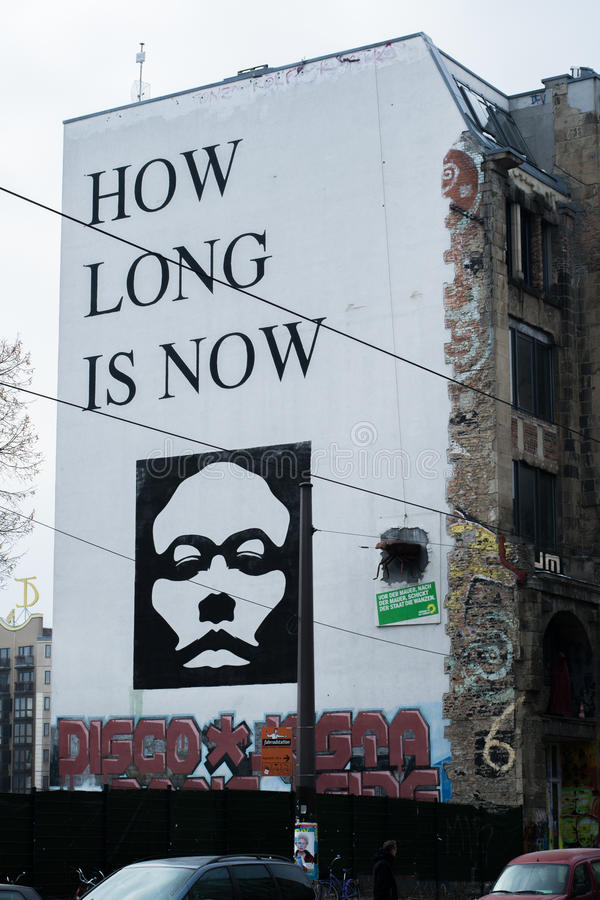 How long is now mural by YZ. On the Kunsthaus Tacheles, Berlin, Germany royalty free stock image