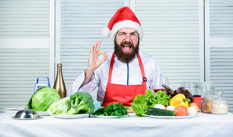 How make your christmas dinner healthier. Responsibility cooking christmas dinner. How to enjoy holiday meals. Man. Bearded chef wear santa claus hat cooking royalty free stock photography