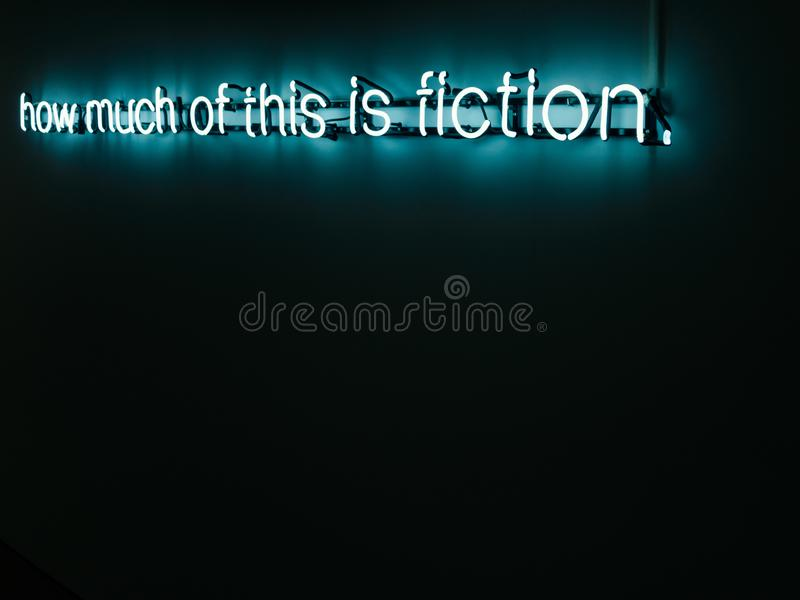 How much of this is fiction neon letter installation. How much of this is fiction neon letter art installation stock photos