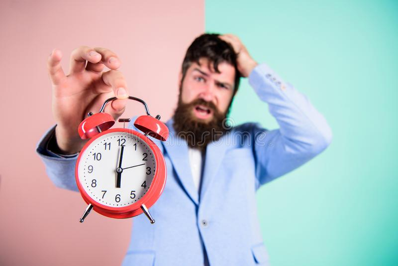 How much time left till deadline. Time to work. Man bearded stressful businessman hold clock. Stress concept. Hipster. Stressful working schedule. Businessman stock images