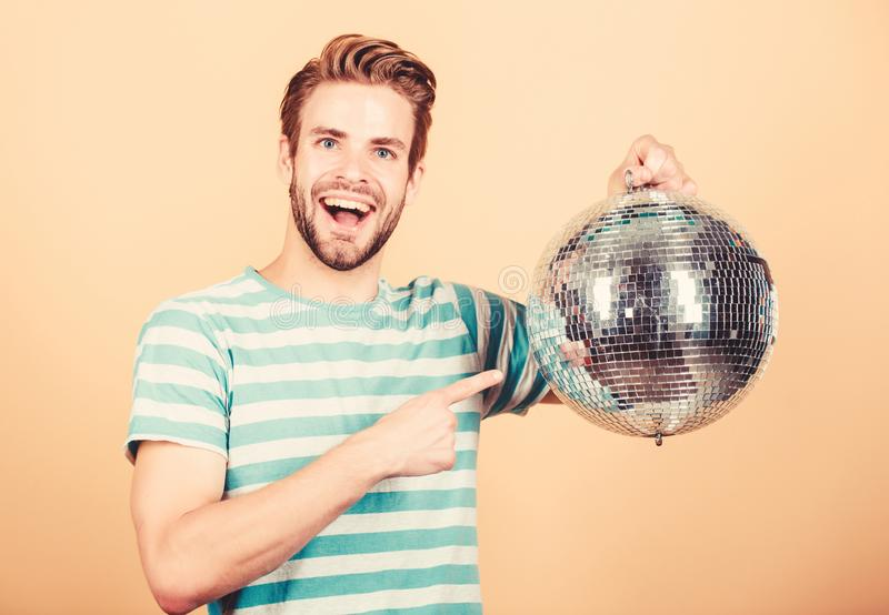 How about party. Handsome man hold disco ball. Disco dances night club. Retro music. Guy inviting you at party. Thousand royalty free stock photo