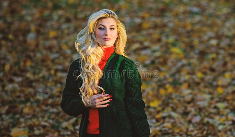 How repair bleached hair fast and safely. Autumn hair care important to avoid dry frizzy hairstyle. Girl gorgeous blonde. Autumn park. Long hair care concept stock image