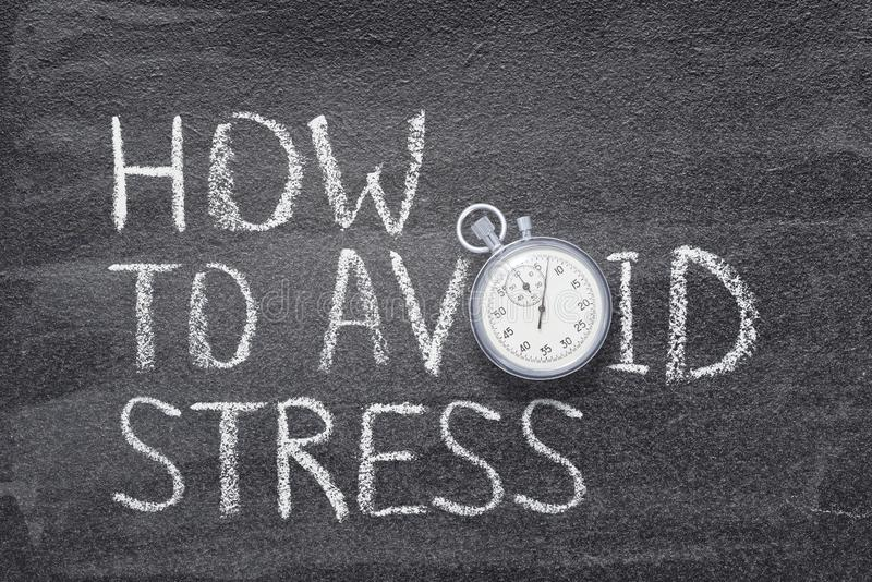 How to avoid stress. Phrase written on chalkboard with vintage stopwatch used instead of O stock photo