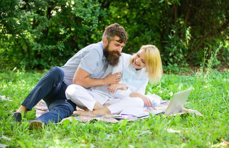 How to balance freelance and family life. Couple youth spend leisure outdoors working with laptop. Couple in love or. Family work freelance. Modern online royalty free stock image