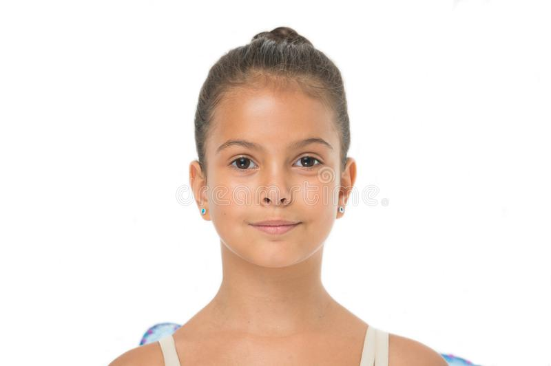 How to do ballet bun. Proper hairstyle for pupil ballerina. Make proper hairstyle visit ballet classes. Girl cute. Smiling face with neat and tidy bun hair royalty free stock photo