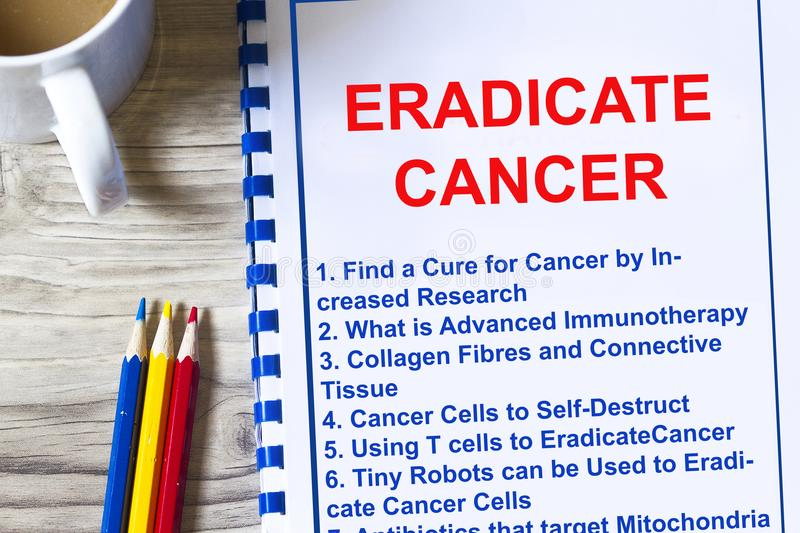 How to eradicate cancer concept. With topics on a lecture coversheet royalty free stock photography