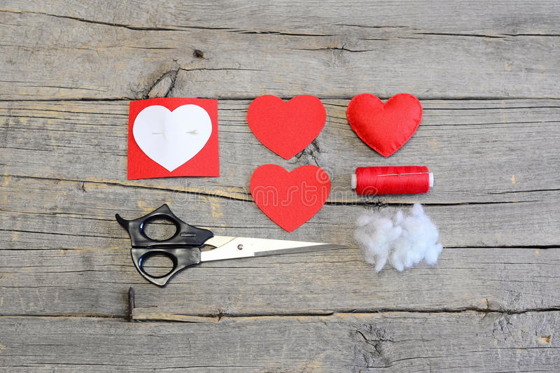 How to hand sew a felt heart for Valentine's day. Tutorial. Red felt heart. Art crafts to decorate living room. Do it yourself decorating concept. Top royalty free stock photos