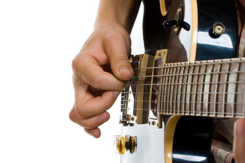How to hold guitar pick. Playing electric guitar stock photography