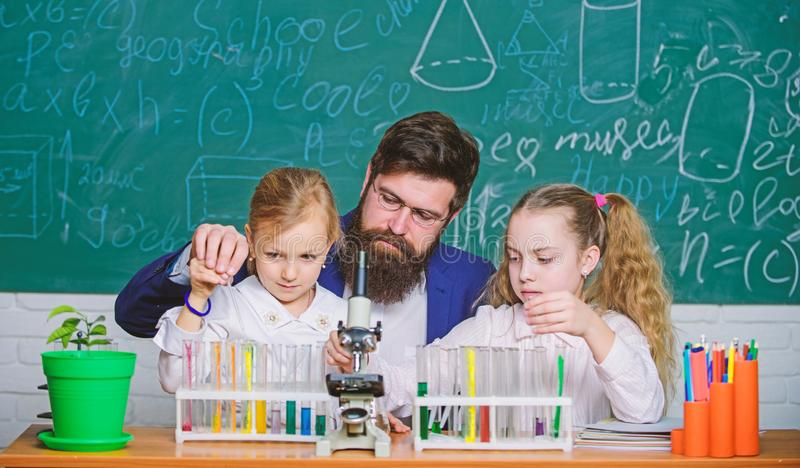 How to interest children study. Explaining biology to children. Fascinating biology lesson. School teacher of biology royalty free stock photos