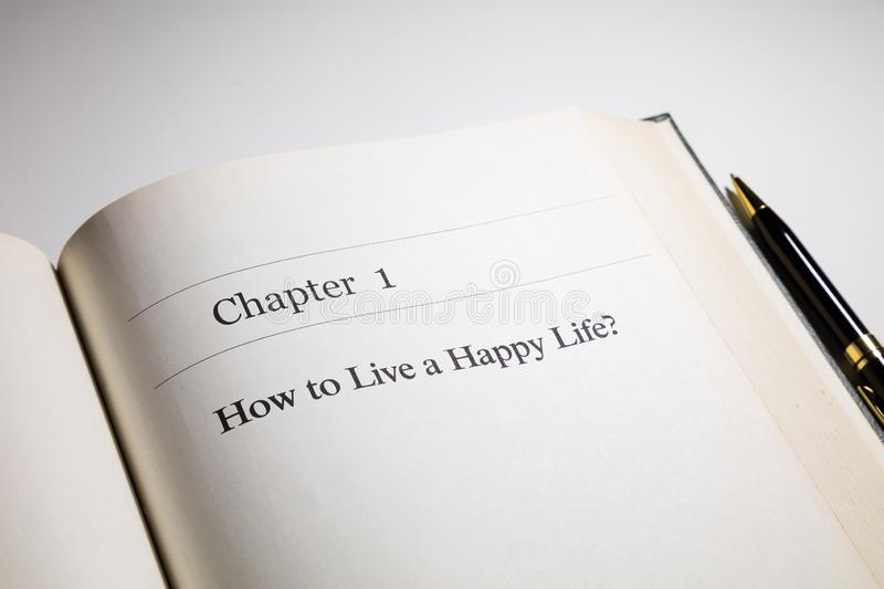 How to live a happy life. ? life philosophy, fake book royalty free stock images