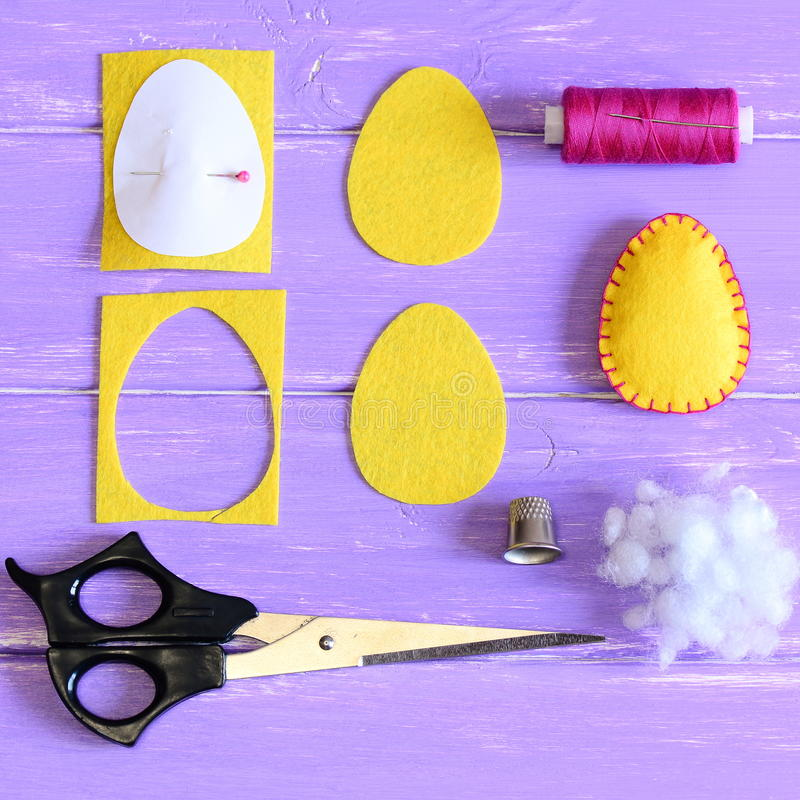How to make cheap Easter egg. Craft guide for kids. Yellow felt Easter egg, cut felt pieces in shape of a egg, paper template. Felt Easter crafts. Felt Easter stock photography