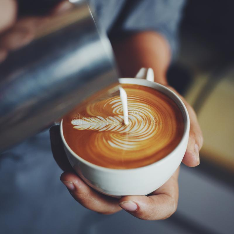 How to make coffee latte art by barista in vintage color tone. How to make coffee latte art by barista coffee shop in vintage color tone royalty free stock images