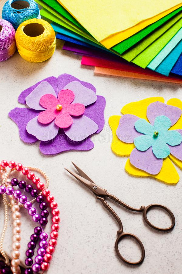 How to make a felt flowers - kids DIY. Crafts tutorial royalty free stock photography